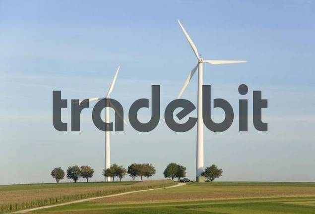 two wind wheels on a hill
